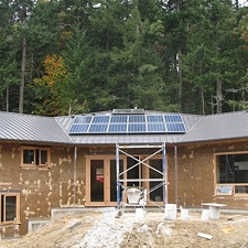 Hempcrete home under construction on Salt Spring Island with rooftop solar array designed and installed by Small Planet Energy.